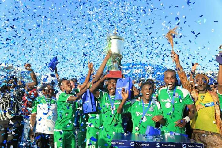 Gor Mahia FC celebrate with the SportPesa Super Cup trophy after beating arch rivals AFC Leopards SC 3-0 in the final at Uhuru Stadium in Dar-es-Salaam on July 11, 2017. PHOTO/SPORTPESA