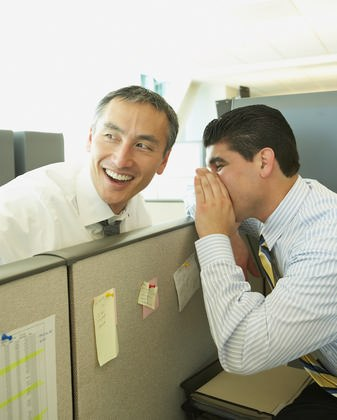 Businessmen Whispering over cubicle - 7 Types Of Men You Find At Every Work Place