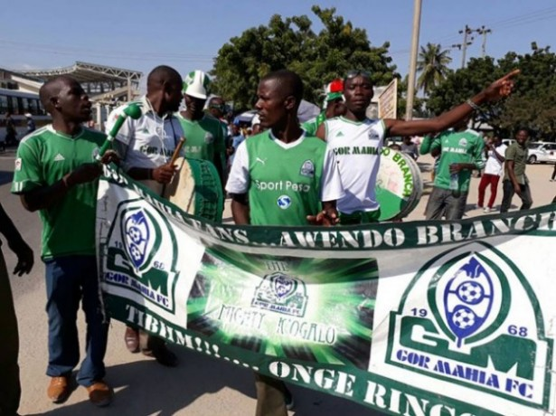 Jubilant Gor Mahia FC fans make their way to the National Stadium in Dar for their game against EPL side Everton FC on July 13, 2017