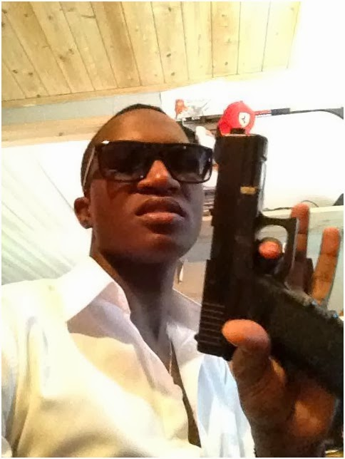 BOSS MOG WITH GUN - Gun play! Nameless shows off a gun looking mean and dangerous (PHOTO)