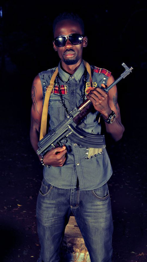 Rio D - Gun play! Nameless shows off a gun looking mean and dangerous (PHOTO)