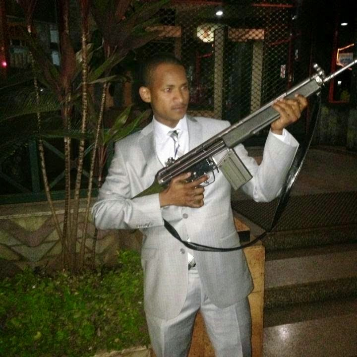 babu owino - Gun play! Nameless shows off a gun looking mean and dangerous (PHOTO)