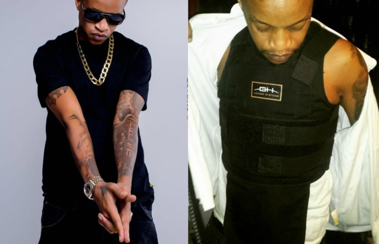 Prezzo Kenya - Gun play! Nameless shows off a gun looking mean and dangerous (PHOTO)