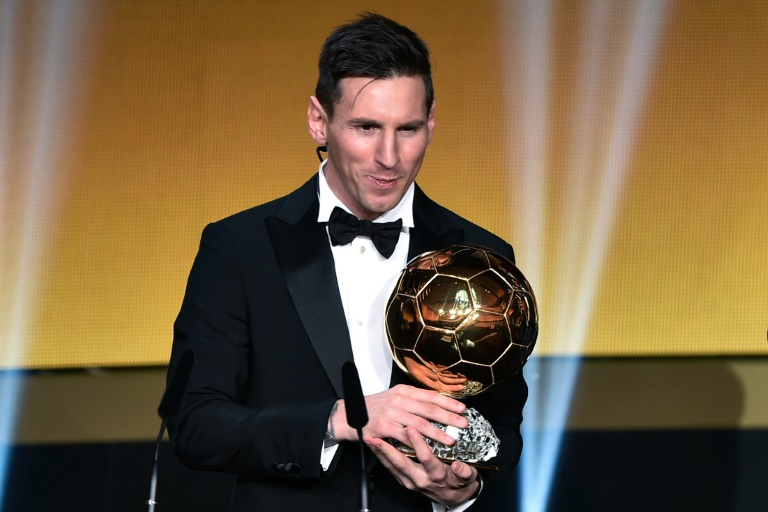 wpid barcelona and argentina forward lionel messi holds his trophy after receiving the 2015 fifa ballon dor award for player of the year in zur1 - Pope Francis warns Messi's fans against referring him as God