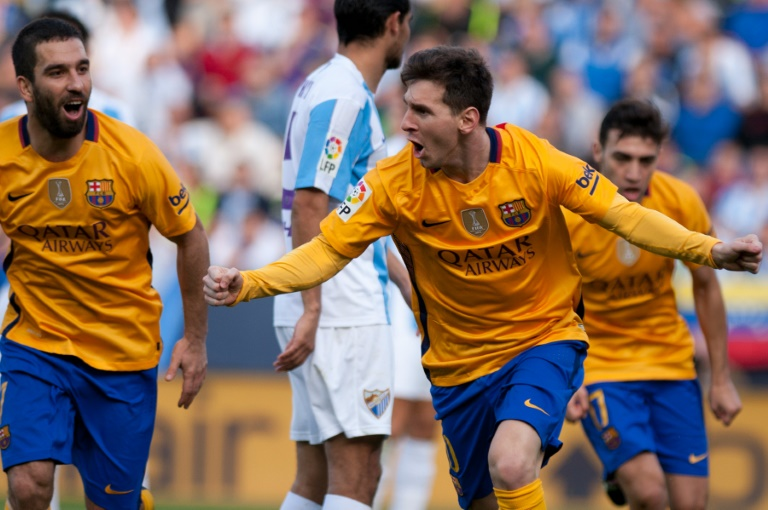 wpid barcelonas forward lionel messi celebrates after scoring during the spanish league football match against malaga at la rosaleda stadium on 1 - Pope Francis warns Messi's fans against referring him as God