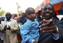 File photo of Deputy President Hon. William Ruto with baby Cherono, whom he has adopted and named Nadia, after his mother. Photo/DPPS