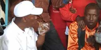 Former Kiambu county governor Hon. William Kabogo eats chapati at a local market. Photo /COURTESY