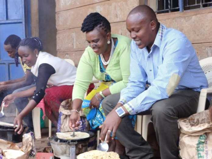 File photo of Juja businessman Mr Ken Ngumba and KIambu TNA coordinator Ms Gladys Chania join Juja youth in cooking one of Kenyan mum favourite meal, chapati. Photo / The Star