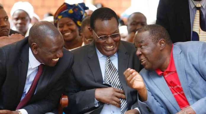 DP William Ruto in a story-telling session with Hon. Chris Obure and Hon. Jimmy Angwenyi. /The Star