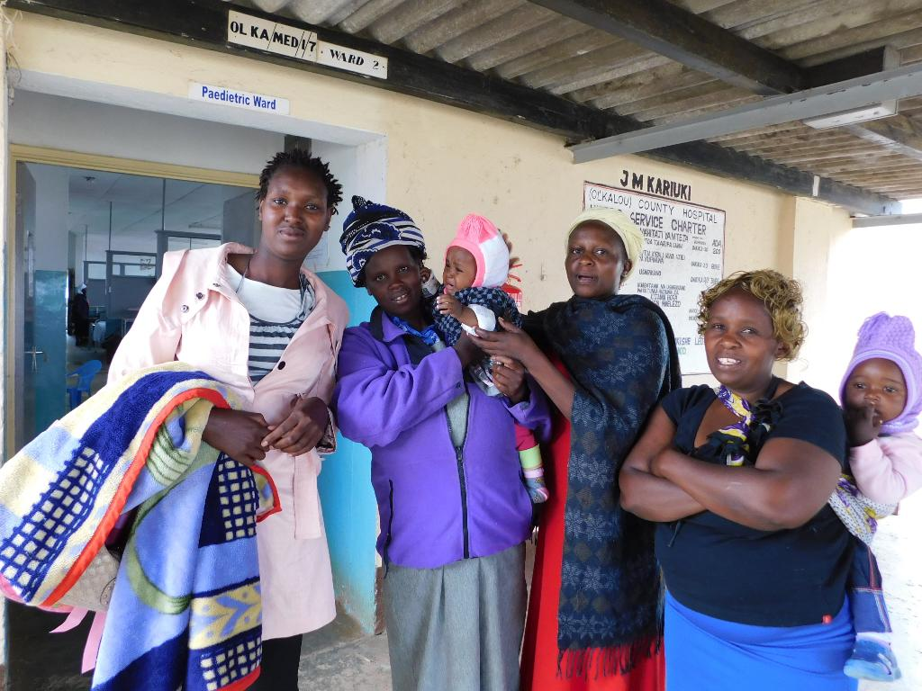 1.Nyandarua Children's officer,Peter Chege,hand-over baby Angel Wanja to her mother,Irene Kendi,at J.M.Memorial hospital on Wednesday afternoon