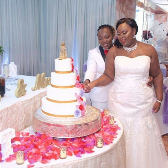 Pictures of 2 Ghanaian lesbians wedding abroad sparks outrage  - 'I am adored,' Gay South African couple shares romantic photos