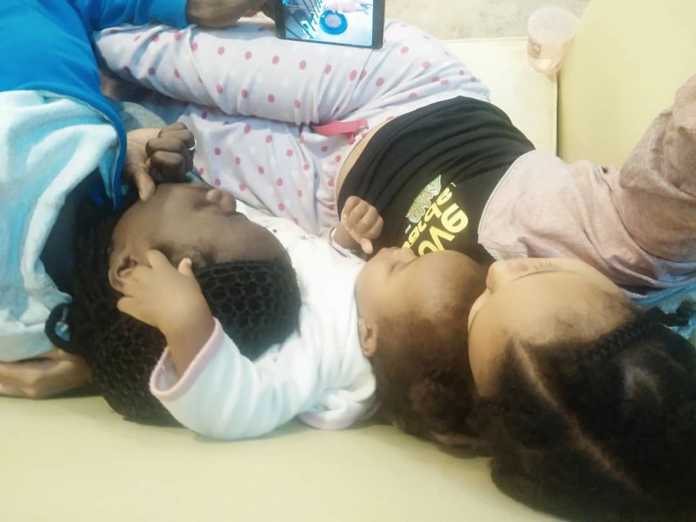 Juliani and Brenda Wairimu with their daughter