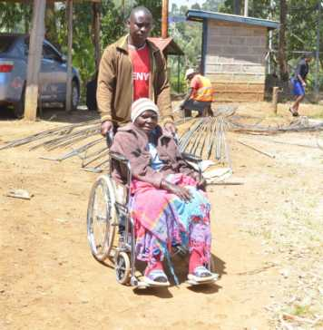 Marcella Mukami, 73, is wheeled into the Kangema law courts on Friday :ALICE WAITHERA