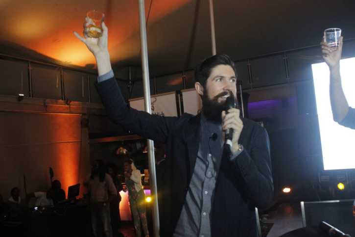 Struan gives a toast towards Scotland during the Glenfiddich Whisky night in Kenya.