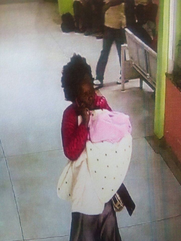 Woman carrying a baby she stole at Kenyatta national hospital