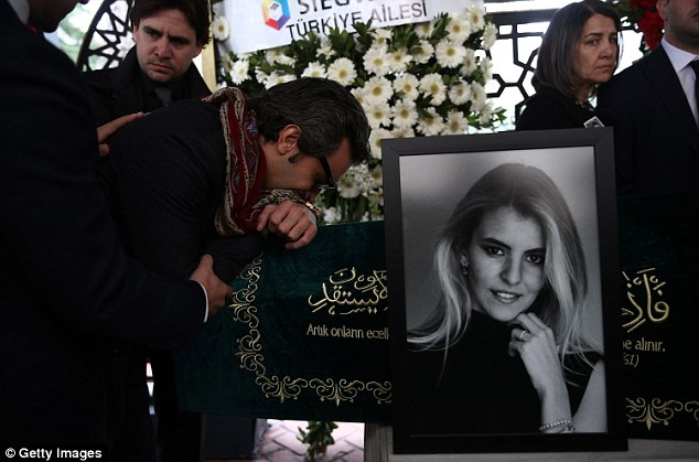 Sorrow: Sinan Urfali, husband of Burcu Gundogar Urfali mourns over her coffin during the funeral ceremony at the Atakoy 5th Section Mosque in Istanbul