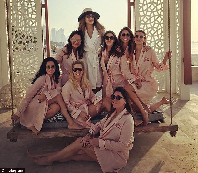 Bride-to-be: Mina Basaran, 28, posted this image on Instagram surrounded by her friends on Saturday as they enjoyed a hen-do weekend in Dubai