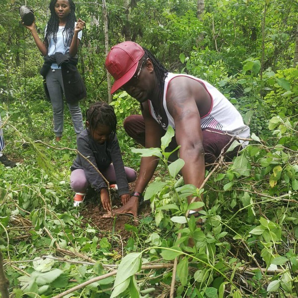 Planting trees with his daughter