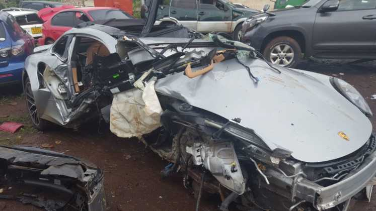 The mangled Porsche wreck of the late John Macharia