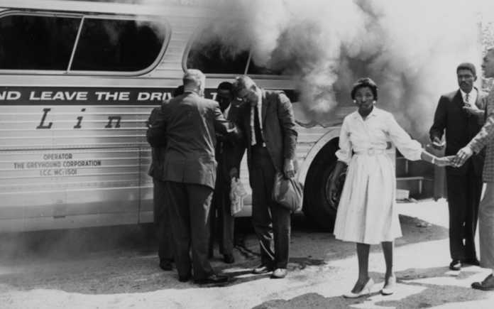 A bus carrying black and white civil rights activists is bombed and burned in Alabama.
