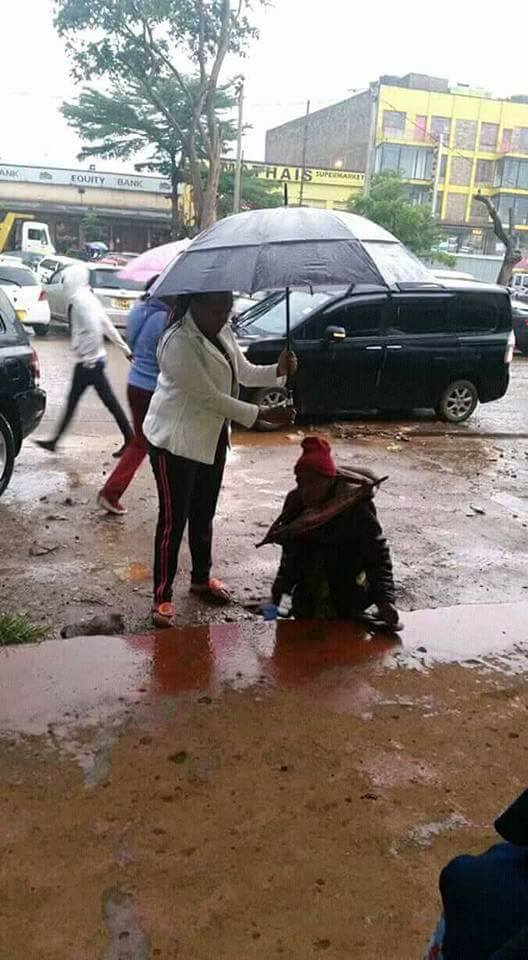 angelic nairobi woman helps disabled man with umbrella