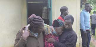 A relative is overcome with grief at Siritanyi in Bungoma county after four people died in the area. Photo/ JOHN NALIANYA