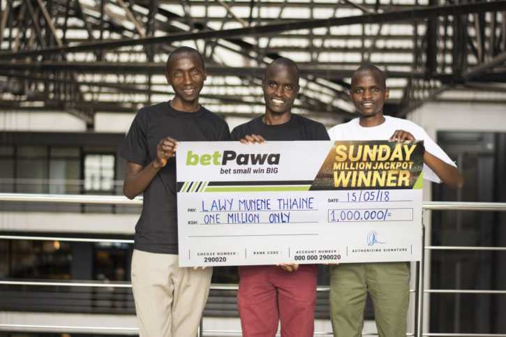 Lawy Munene displays his cheque after winning betPawa jackpot last week