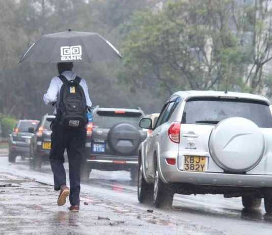 A man running in the rain along Waiyaki way westlands on Tuesday 14th November 2017.