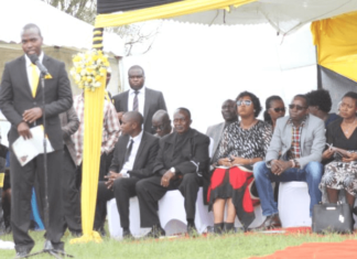 Shadrack Kiprop (standing in black suit), reads the eulogy of his late mother, former Baringo South Member of Parliament (MP) Grace Kipchoim at Kimoriot on May 5.