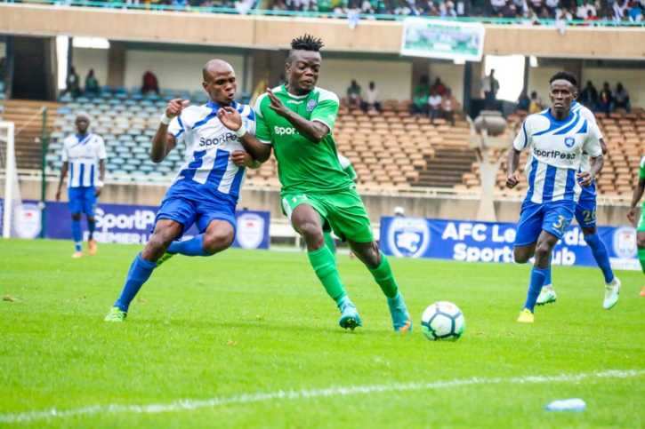 Gor Mahia FC striker Ephrem Guikan in green tussle for the ball with an AFC Leopards SC defender at the 84th Mashemeji Derby at Kasarani in Nairobi on July 22 2018
