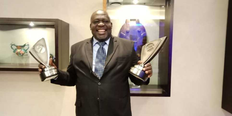 Gor Mahia's Gerphas Okuku holds the awards that SportPesa bagged in South Africa