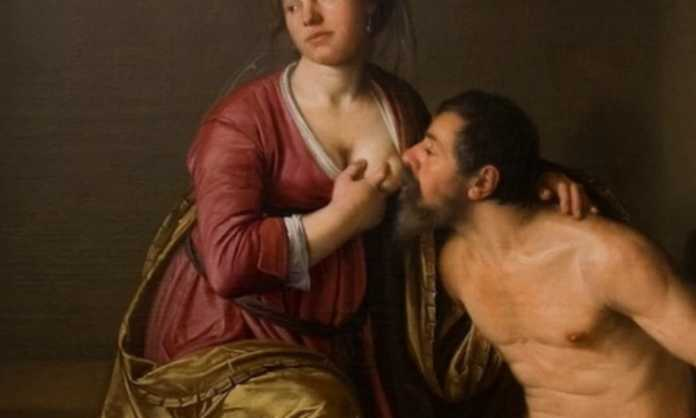 guy breastfeeding from his wife