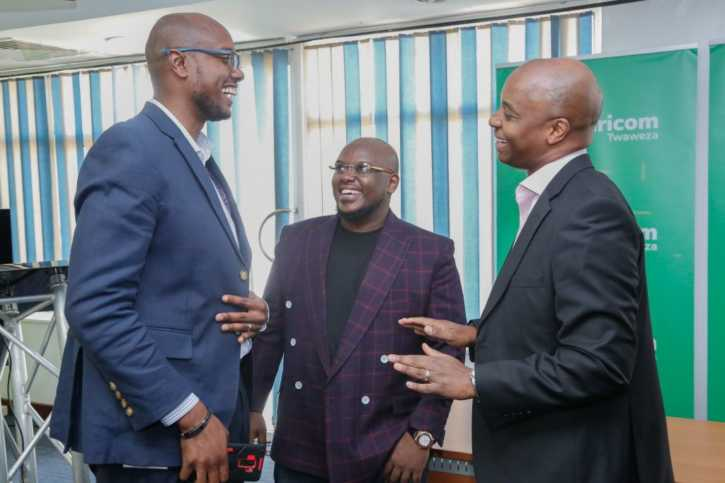 Safaricom Director Corporate Affairs, Steve Chege (right) interacts with Genge Artist Hubert Nakitare  AKA Nonini (center) and Safaricom AG Director Consumer Business Unit (left) after signing an MOU of the partnership with Safaricom.
