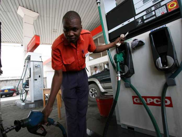 An attendant at a petrol station