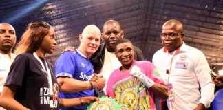 World Boxing Council (WBC) Women Super Bantamweight champion,Fatuma 'Iron Fist' Zarika , celebrates her second successful title defence with Jakob Kristensen, Global Chief Operations Officer, SportPesa (blue top) and Kenya Professional Boxing Commission Vice Chairman, George Adipo (right) at the KICC in Nairobi on September 8, 2018.PHOTO/SPN