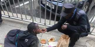 Security guard feeds a disabled woman