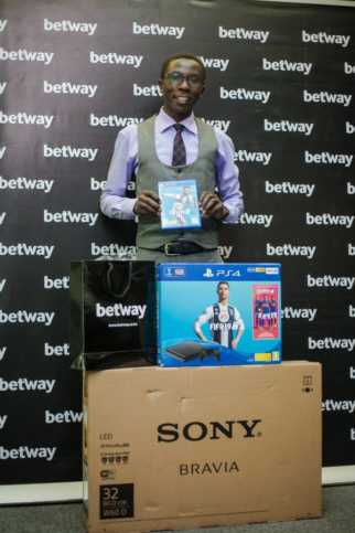 Winner Wycliffe Michieka receiving his prizes for the yearly 30 thousand prizes in 30 days where he emerged the winner of the grand prize.