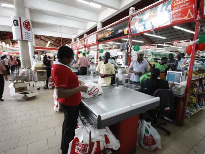 An attendant serves customers at an Uchumi outlet / FILE