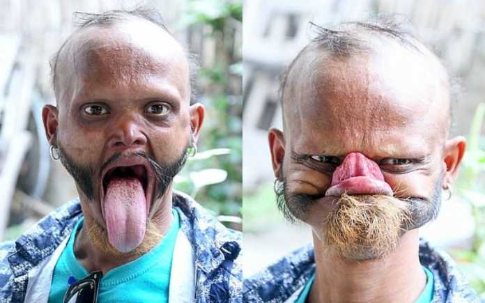 Man licking forehead by his tongue