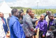 President Uhuru Kenyatta accompanied by AU Special Envoy Raila Odinga are welcomed at the late Bruce Odhiambo's home in Muhoroni in Saturday, January 19, 2019./ MAURICE ALAL