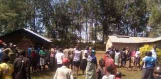 Residents of Sindani village, Bungoma, in the home where a man was killed allegedly by his two sons over a quarrel with the wife on Monday night /BRIAN OJAMAA