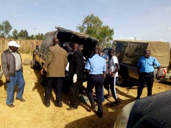 Police take away the body of John Maina who was killed at his farm in Silanga village, Ol Kalou, Wednesday, February 7, 2019. /NDICHU WAINAINA