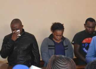 Joseph Kori wiping tears while in court with Judy Wangui and Micheal Mathenge during the murder case of Mary Wambui./STANLEY NJENGA