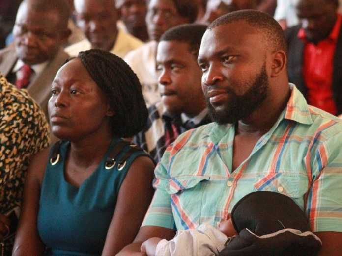 Baby Samantha Pendo's parents Lencer Achieng' and Joseph Abaja at the Kisumu law courts during the ruling on the inquest. /FAITH MATETE