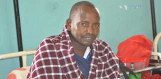 Teacher John Matipei recuperates at Kajiado County Referral Hospital on February 18 after he was attacked by a hyena on Valentine's Day.