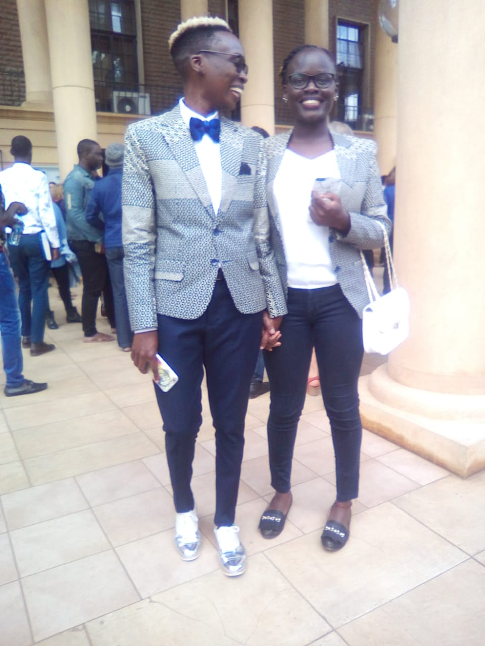 9534b907 b3b5 43e1 b44d 1a1458640af1 - Strike a pose: Lesbian couple steps out in matching outfits [PHOTOS]