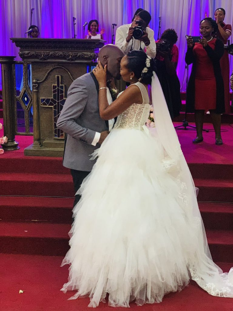 Dennis okari kiss bride Naomi Joy 768x1024 - Opinion: From cuckold to true love: Okari rebounds from Betty Kyallo