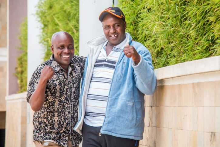 SportPesa Mid Week Jackpot winner Nicholas Kirui poses with a friend when he came to collect his KSh8,819,633 cheque on Monday, February 25, 2018. PHOTO/SPN