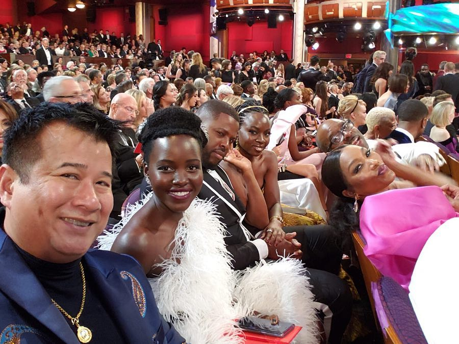 lup2 - Hit or miss? Lupita wears feather dress to the Oscars