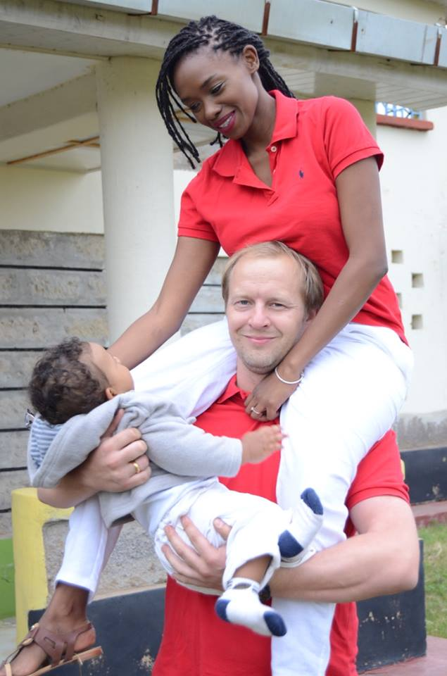 Stella Adam with her husband and son